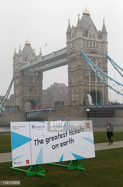 A woman walks past a giant mock ticket outside City Hall following a photocall to officially launch the sale of tickets for the London 2012 Olympic...