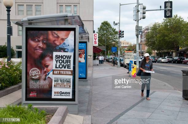 hiv testing poster at bus stop - psa stock photos and pictures