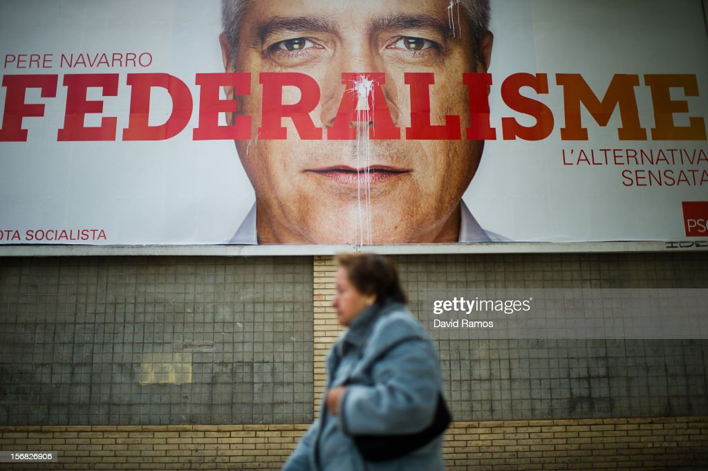 A woman walks past a left-wing and Anti-separatist Socialist Party of Catalonia poster that it reads 'Federalism' on November 22, 2012 in Barcelona, Spain. Over 5 million Catalans will be voting in Parliamentary elections on November 25.