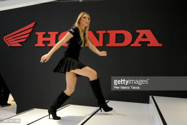 A woman walks past a logo at the Honda motorbike show room during the EICMA 2013 71st International Motorcycle Exhibition on November 6 2013 in Milan...
