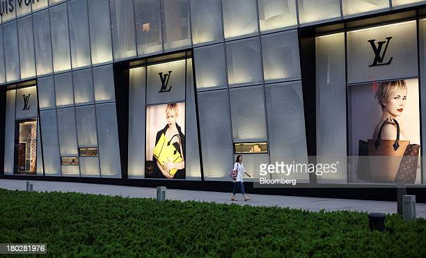 A woman walks past a Louis Vuitton store operated by LVMH Moet Hennessy Louis Vuitton SA in Dalian China on Tuesday Sept 10 2013 Goldman Sachs Group...