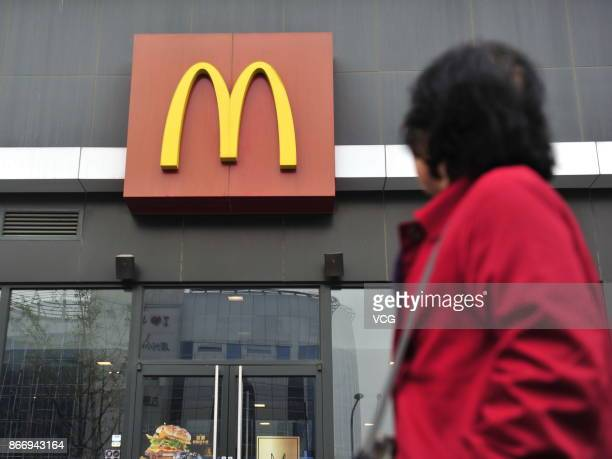 Woman walks past a McDonald's restaurant on October 26, 2017 in Beijing, China. McDonald's China has changed its company name from Maidanglao, a...
