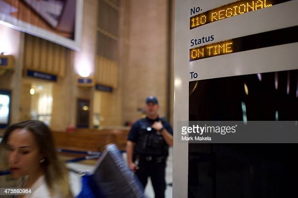 A woman walks past a notice board before purchasing a train ticket at 30th Street Station for the 553am first train as Amtrak resumes northbound...