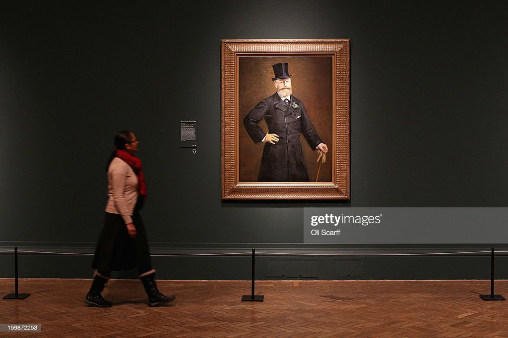 A woman walks past a painting by Edouard Manet entitled 'Portrait of M.Antonin Proust' in the Royal Academy of Arts on January 22, 2013 in London, England. The painting features in the Royal Academy's new exhibition 'Manet: Portraying Life' which displays over 50 paintings spanning his career. The exhibition open to the general public on January 26, 2013 and runs until April 14, 2013.
