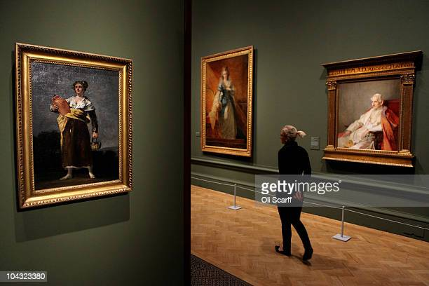 A woman walks past a painting by Goya entitled 'Watercarrier' at the exhibition 'Treasures from Budapest' at the Royal Academy of Arts on September...