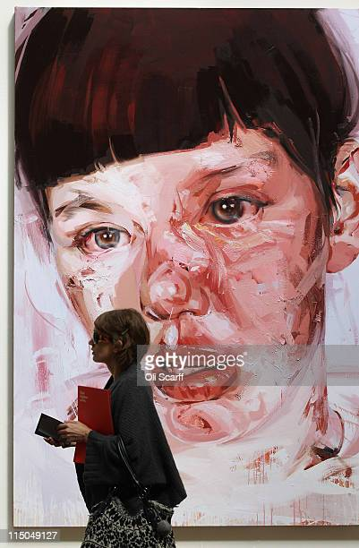 A woman walks past a painting by Jenny Saville entitled Red Stare Head IV on display in the Royal Academy of Arts' Summer Exhibition on June 2 2011...
