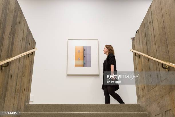 A woman walks past a piece entitled 'Mobile No 3' by Andreas Gursky in the reopened Hayward Gallery on January 24 2018 in London England