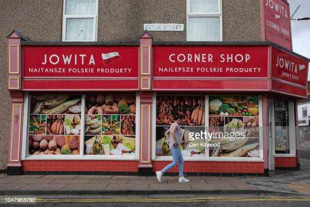 A woman walks past a Polish Supermarket on October 8 2018 in Grimsby England Grimsby was once home to the largest fleet of fishing trawlers in the UK...