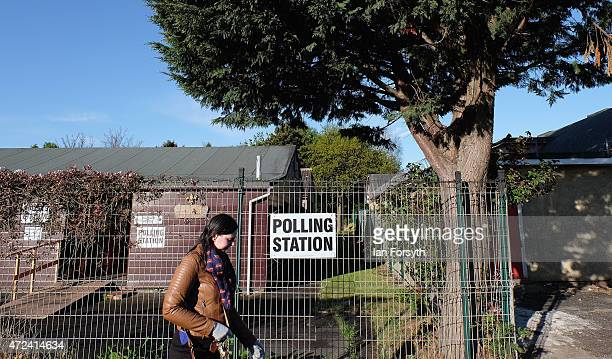 A woman walks past a polling station situated in a scout hut on May 7 2015 in Eston England The nation goes to the polls today to vote on what is...