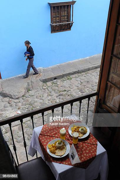A woman walks past a restaurant in Candeleria in the old part of the city Bogota formerly called Santa Fe de Bogota is the capital city of Colombia...