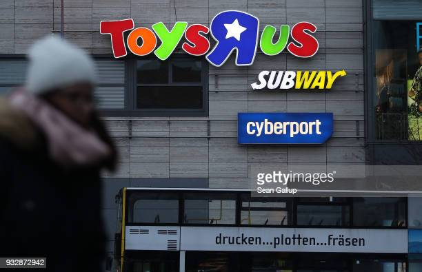 A woman walks past a shopping mall that includes a Toys 'R' Us store in Steglitz district on March 16 2018 in Berlin Germany The future of the...