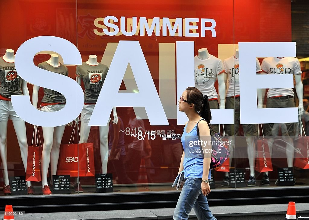 A woman walks past a sign advertising a  : News Photo