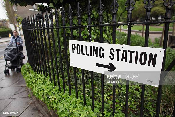 Woman walks past a sign for a polling station in North London as the public votes for the next Mayor of London and in local elections on May 3, 2012...