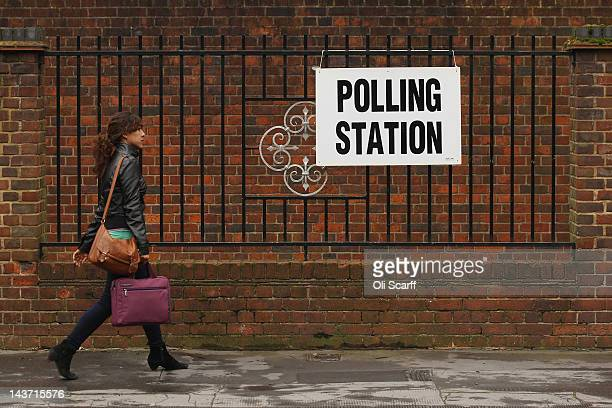 A woman walks past a sign for a polling station in North London as the public votes for the next Mayor of London and in local elections on May 3 2012...