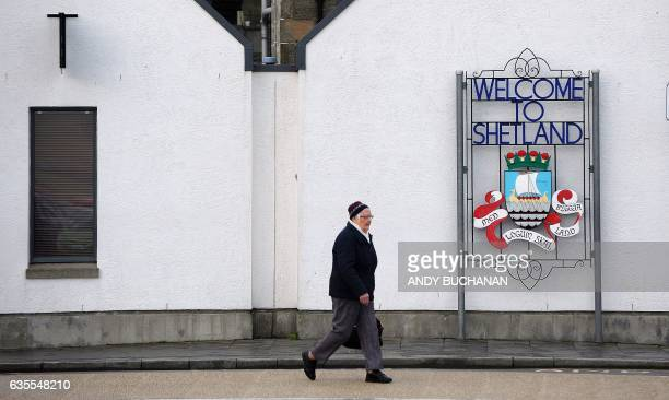 A woman walks past a 'Welcome to Lerwick' sign in Lerwick Shetland Islands on February 4 2017 Of all the ramifications of the Brexit vote the fate of...