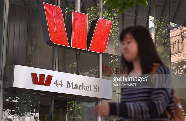 A woman walks past a Westpac Bank sign in central Sydney on October 14 as the Australian banking giant said it was raising 35 billion AUD in capital...