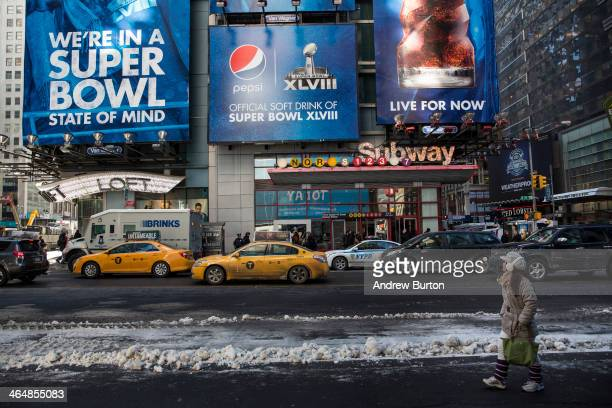 A woman walks past an advertisement referencing Super Bowl XLVIII which will be played in East Rutherford NJ in two weekends on January 24 2014 in...