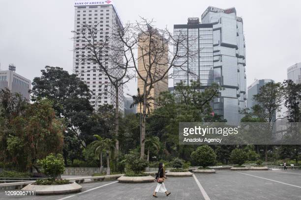 A woman walks past an empty Chater Garden at the Central financial district of Hong Kong China on April 3 2020