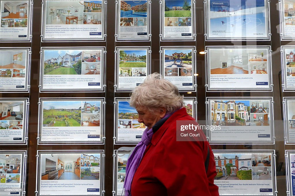 A woman walks past an estate agents on December 4, 2014 in in East Dulwich, London, England. In his autumn statement, Chancellor of the Exchequer, George Osborne, cut the rate of stamp duty for lower-value house sales and raised it on those worth more than £1.5m in a move that would cut the rate of tax for 98% of house purchases.