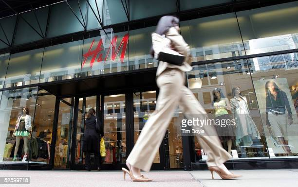 A woman walks past an HM clothing store April 7 2005 in Chicago Illinois Sweden's Hennes Mauritz AB Europe's largest fashion retailer has said its...