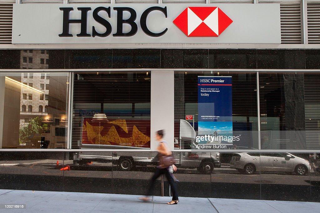 A woman walks past an HSBC Bank branch at 110 William Street