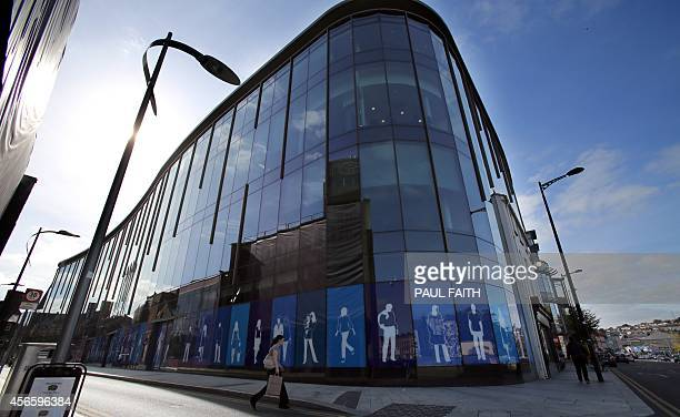 A woman walks past Apple's new offices on Half Moon Street in Cork city centre southern Ireland on October 2 2014 Perched on top of a hill...
