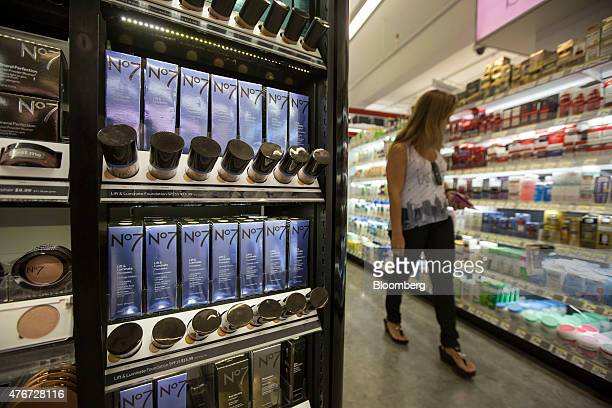 A woman walks past Boots No7 cosmetics displayed for sale at a Walgreens Boots Alliance Inc store in New York US on Wednesday June 10 2015 Walgreens...