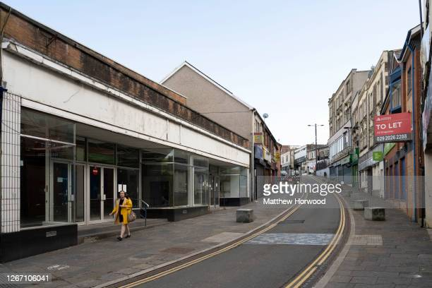 Woman walks past closed shops and empty commercial property on August 18, 2020 in Bargoed, Wales. The Office For National Statistics reported the...