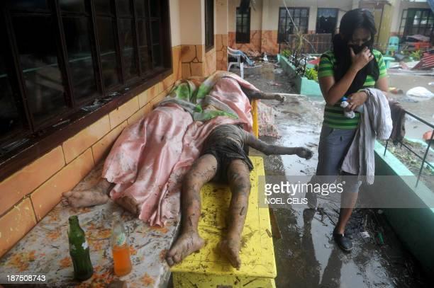 Woman walks past dead bodies inside the Fisherman's Village Elemantary School in Tacloban, eastern island of Leyte on November 10, 2013. The Pentagon...