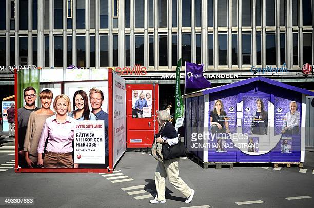 A woman walks past election posters advertising different political parties for the upcoming European elections in Stockholm on May 25 2014 Stockholm...