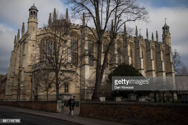 A woman walks past Eton School Chapel near Windsor Castle on November 29 2017 in Windsor England Prince Harry and Meghan Markle are due to marry in...