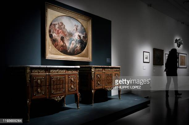 Woman walks past furnitures of the Marly castle displayed during a visit of the museum of the royal domain of Marly in Marly-le-Roi on January 14,...