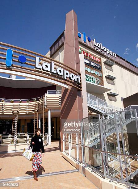 A woman walks past in front of Mitsui Fudosan Co's LaLaport Yokohama in Kanagawa prefecture Japan on Monday March 12 2007 The Topix real estate index...