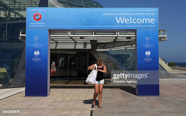 A woman walks past in front of the placard prior to the UEFA Champions League draw at the Grimaldi Forum building in Monaco on August 27 2014 The 32...