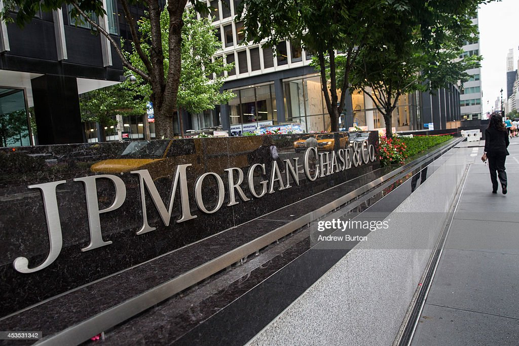 A woman walks past JP Morgan Chase's corporate headquarters on August 12, 2014 in New York City. U.S. banks announced second quarter profits of more than $40 billion, showing strong signs of a recovering economy.