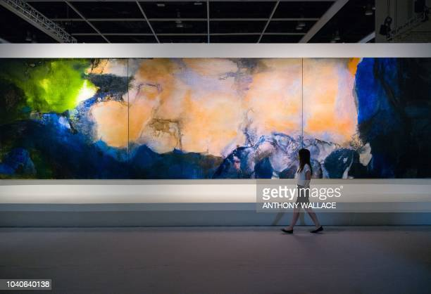 A woman walks past 'JuinOctobre 1985' by Chinese painter Zao WouKi during a media preview for the piece at the Sothebys auction house showroom in...