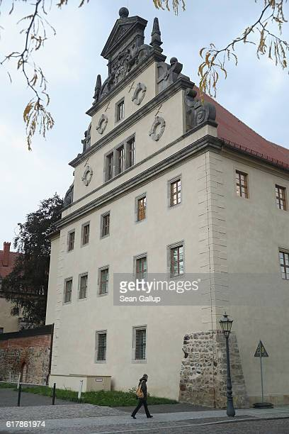 A woman walks past Luther Haus the building where theologian Martin Luther lived and that is now a museum on October 20 2016 in Wittenberg Germany In...
