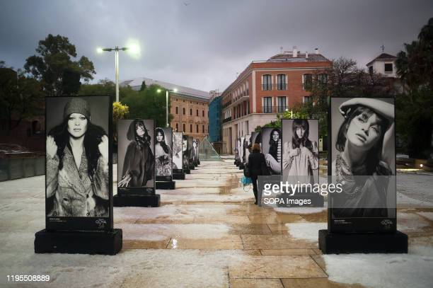 Woman walks past portraits of Spanish actress Pepa Flores known as after a heavy hailstorm in downtown Malaga caused by storm Gloria.