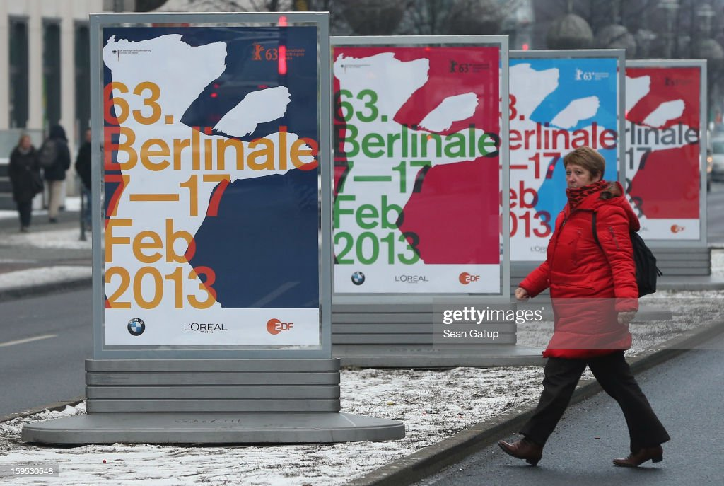 A woman walks past posters advertising the 63rd Berlinale International Film Festival on January 15, 2013 in Berlin, Germany. The 2013 Berlinale will run from February 7-17, 2013.