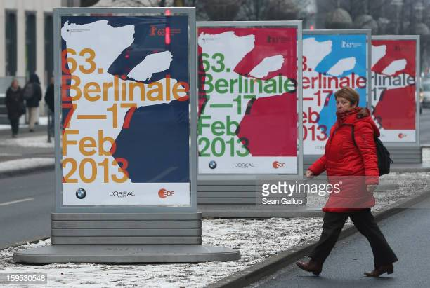 A woman walks past posters advertising the 63rd Berlinale International Film Festival on January 15 2013 in Berlin Germany The 2013 Berlinale will...