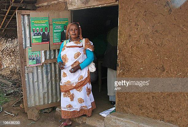 A woman walks past presidential campaign posters on November 2 2010 in the Comoros Island of Moheli The governors of the archipelago's three islands...