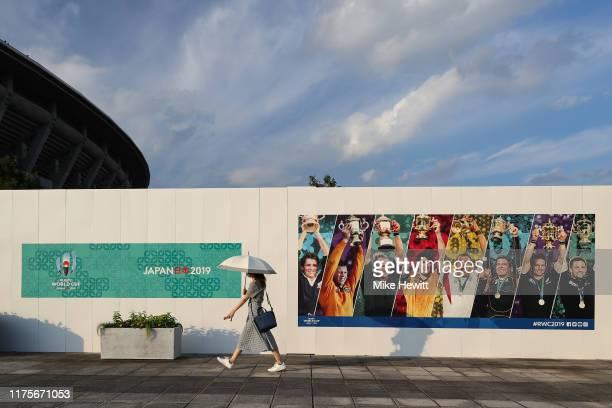 Woman walks past Rugby World Cup branding at the International Stadium Yokohama ahead of the Rugby World Cup on September 19, 2019 in Yokohama, Japan.