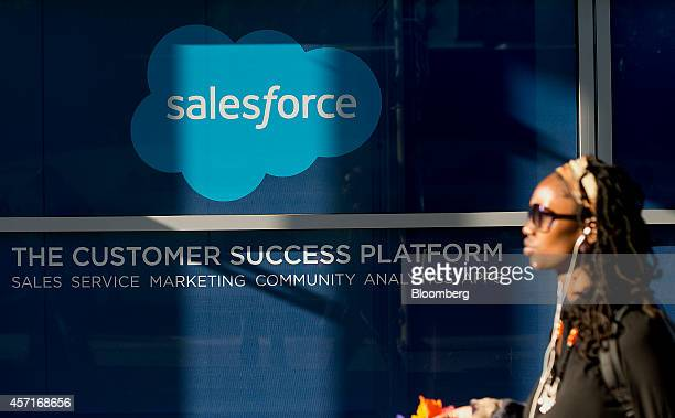 Woman walks past Salesforce.com signage at the DreamForce Conference in San Francisco, California, U.S., on Monday, Oct. 13, 2014. Salesforce.com...