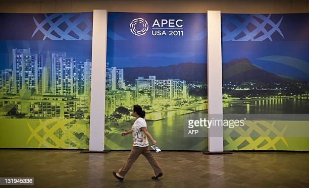 Woman walks past signage at the Hawaii Convention Center in Honolulu, Hawaii on November 8, 2011 ahead of the Asia-Pacific Economic Cooperation...