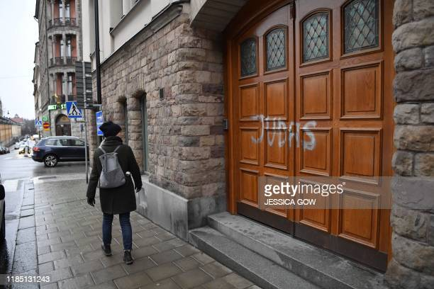A woman walks past Swedish football player Zlatan Ibrahimovic's residence in Stockholm where someone sprayed Judas on the the door to the building in...