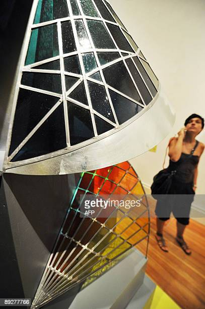 A woman walks past Swiss artist Johannes Itten's 'Tower of Fire' at the 'Bauhaus A Conceptual Model' exhibition in Berlin on July 23 2009 The...
