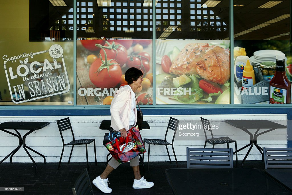 A woman walks past tables and chairs set up outside of a Whole Foods Market Inc. location in Redondo Beach, California, U.S., on Tuesday, Nov. 5, 2013. Whole Foods Market Inc. is scheduled to release earnings figures on Nov. 6. Photographer: Patrick T. Fallon/Bloomberg via Getty Images