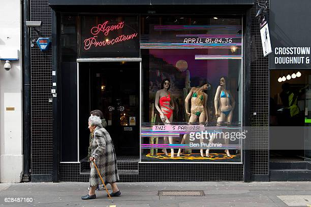 A woman walks past the Agent Provocateur boutique in Soho on March 29 2016 in London England Long established as the West Ends entertainment district...