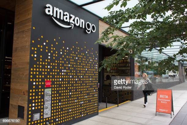 A woman walks past the Amazon Go grocery store at the Amazon corporate headquarters on June 16 2017 in Seattle Washington Amazon announced that it...