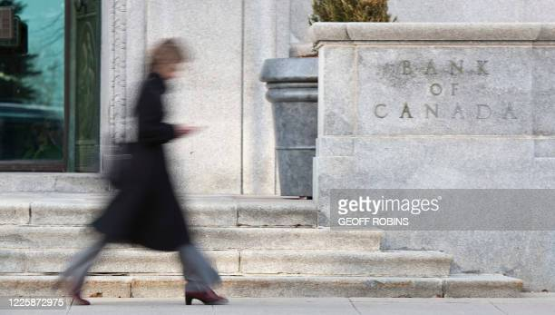 Woman walks Past the Bank of Canada building in Ottawa on April 12, 2011. The central bank announced that it was maintaining the key lending rate at...